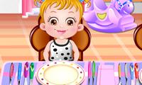 Bébé Hazel débarrasse la table